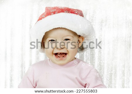 Cute baby girl with Santa hat  - stock photo