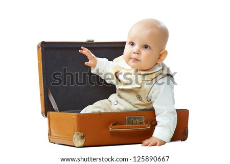 Cute baby in vintage suitcase on a white background - stock photo