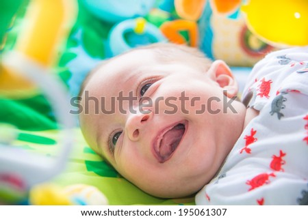 Cute baby laughing - stock photo