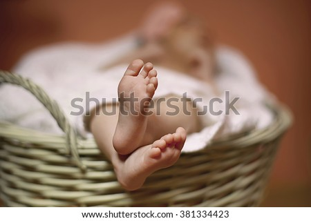 Cute Baby Legs in Basket - stock photo
