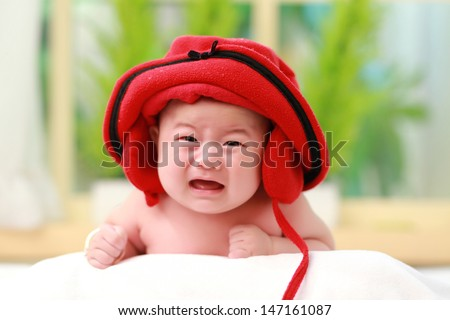 Cute baby lie prone and cry - stock photo