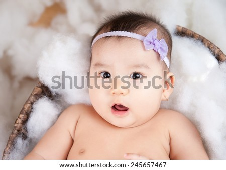 Cute baby look at camera with surprise face - stock photo