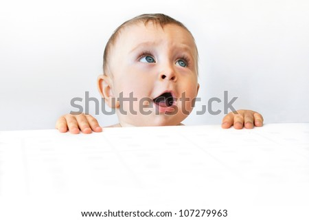 Cute baby looking up - stock photo
