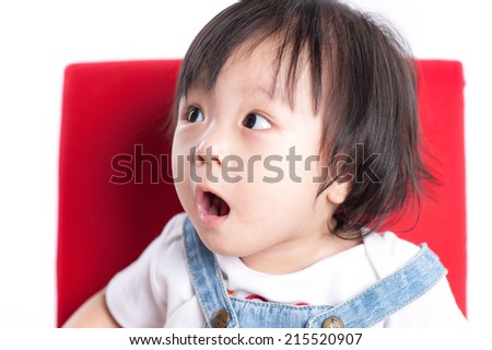 Cute baby looking up with surprise face - stock photo
