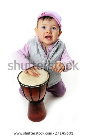 Cute baby musicians play his drum - stock photo
