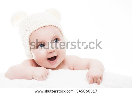 Cute baby on white background.Close up of a caucasian baby boy,four months old baby looking up - stock photo