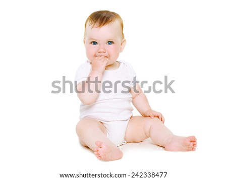 Cute baby sitting on a white background - stock photo