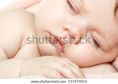 cute baby sleeping, beautiful kid's face closeup, studio shot - stock photo