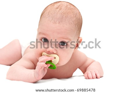 Cute baby sucks a dummy - stock photo