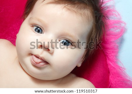 cute baby surprised, beautiful kid's face closeup, studio shot - stock photo