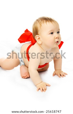 cute baby tied up with a red ribbon isolated against white background - stock photo
