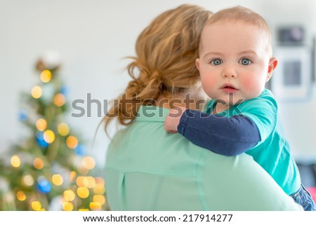 Cute baby waiting for Christmas - stock photo