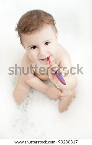 cute baby washing teeth with teeth brush - stock photo