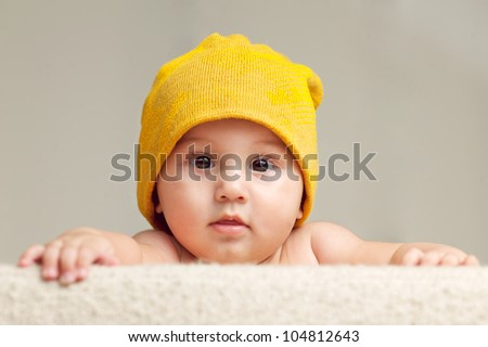 Cute Baby With Beanie Hat - stock photo