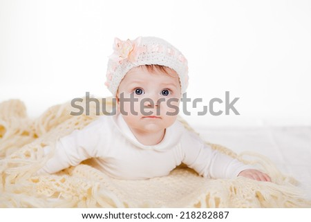 Cute baby with beautiful blue eyes on the white background - stock photo