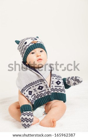 cute baby with hat and scarf in studio - stock photo