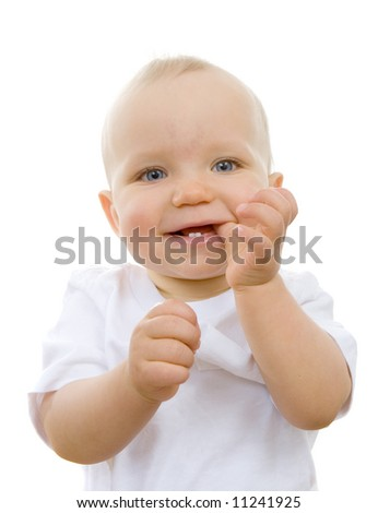Cute baby with thumb in his mouth and teeth - stock photo