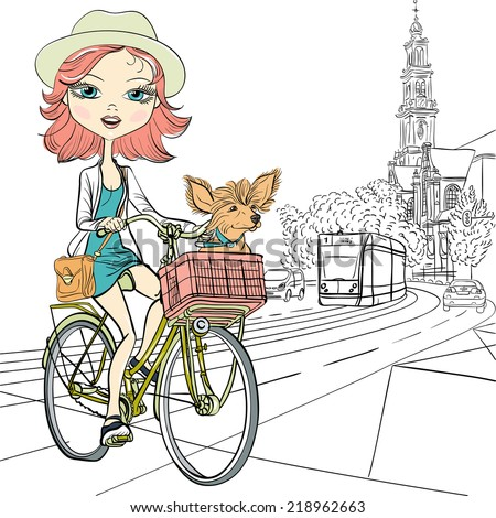 Cute beautiful fashionable girl with dog rides a bike in Amsterdam - stock photo