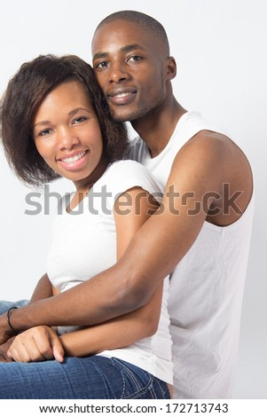Cute Black couple cuddle on Valentines Day - stock photo