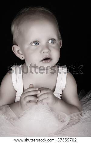 Cute blond baby ballerina looking into the distance - stock photo