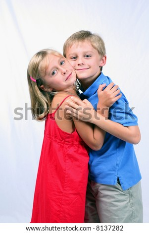 cute blond boy and girl hugging - stock photo