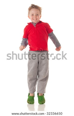 Cute blond boy jumping, isolated on white - stock photo
