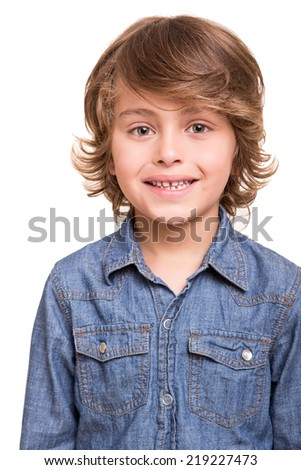 Cute blond boy posing over white background - stock photo