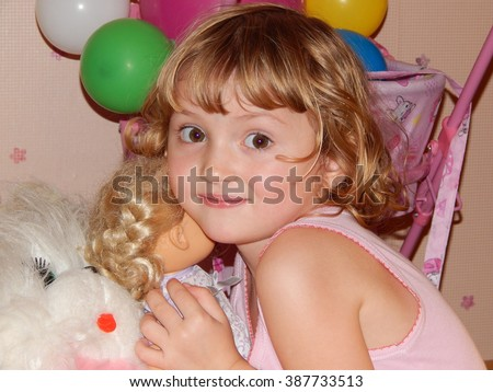Cute blond girl playing with toys close up   - stock photo