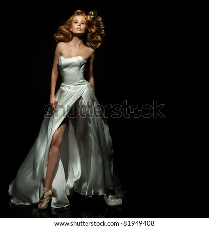 Cute blond lady on black background - stock photo