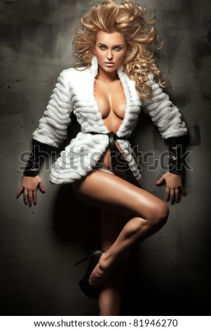 Cute blonde beauty posing - stock photo