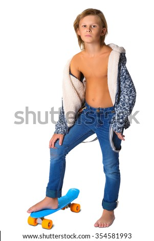 Cute blonde boy or teenager in full length casual style blue jeans posing with skateboard pennyboard isolated on white. - stock photo