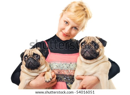 Cute blonde holding two pugs - stock photo