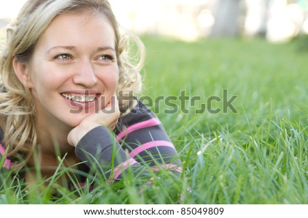cute blonde woman posing at the nature - stock photo