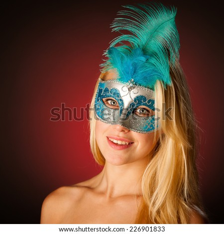 Cute blonde woman with venice mask on her face glamorous portrait on colorful background - stock photo
