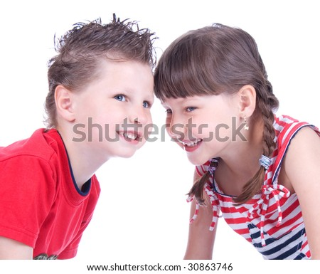 Cute blue-eyed boy and girl are playing , studio shot - stock photo