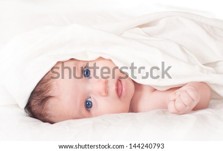 Cute blue-eyed newborn baby. - stock photo
