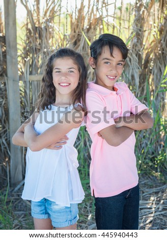 Cute boy and girl on the nature - stock photo