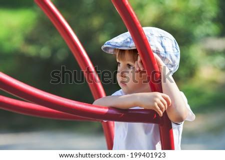 Cute boy, climbing on the playground - stock photo