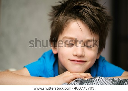 cute boy dreaming - stock photo