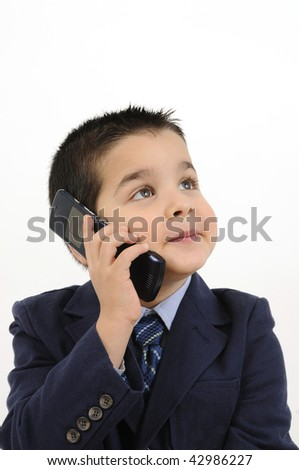 Cute boy dressed as businessman on the phone isolated on white background - stock photo