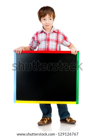 Cute boy holding a blackboard over white background - stock photo