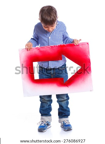 Cute boy holding red arrow. Isolated on white background - stock photo
