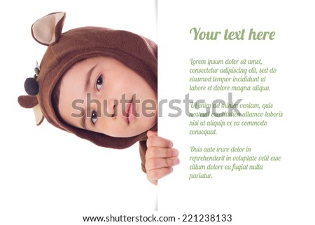 Cute boy in a bear suit holding big blank paper sheet isolated on a white background - stock photo