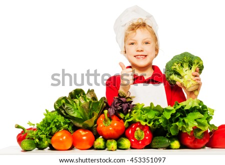 Cute boy in cook's uniform with healthy food - stock photo