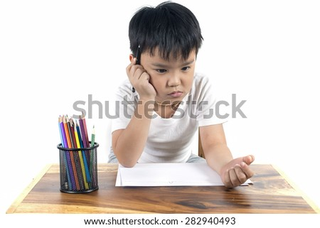 Cute boy is drawing using color pencils, isolated over white   - stock photo