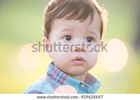 cute boy is looking somewhere, caucasian - stock photo