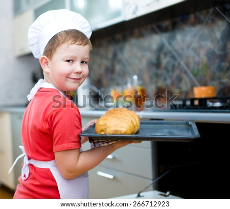 Cute boy making bread in the kitchen - stock photo
