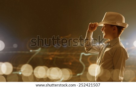 Cute boy of school age against bokeh background - stock photo