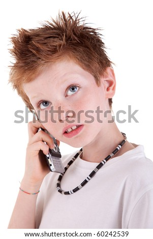 cute boy on the phone,looking up,  isolated on white background, studio session - stock photo