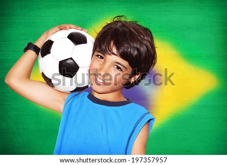 Cute boy playing football, happy child, young male teen goalkeeper enjoying sport game, holding ball, portrait of a preteen smiling and having fun, kids activities, little footballer - stock photo
